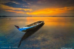 empty boat sunset batam island chuang tzu merton